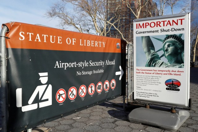 Image: A sign announcing the closure of the Statue of Liberty, due to the U.S. government shutdown, sits near the ferry dock to the Statue of Liberty at Battery Park in Manhattan, New York