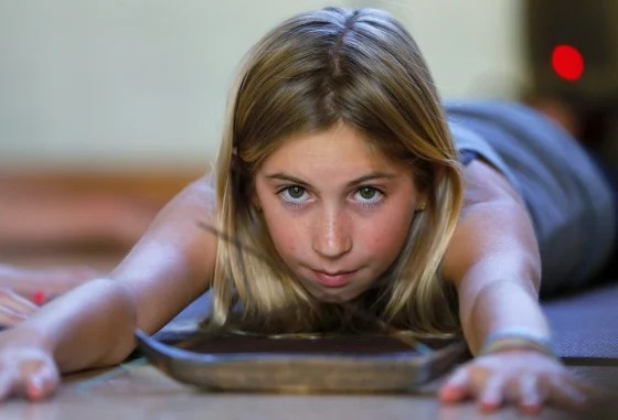 Twelve-year-old certified yoga instructor Jaysea DeVoe teaches her yoga class at the Bergamot Spa in Encinitas, California March 18, 2014. DeVoe is ju...