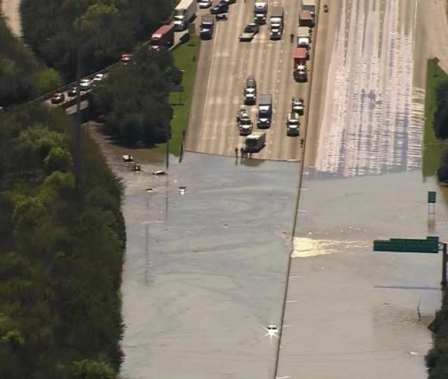 Water Main Break Submerges Houston Highway Threatens Homes
