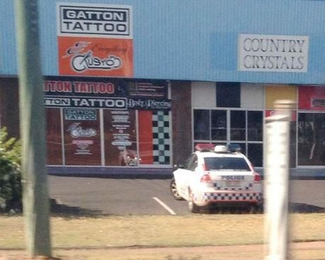 "Police keep surveillance over Gatton Tattoos, owned by Life and Death Motorcycle Club chapter president Tony ""Bones"" Lowe until he sold it to his son last week. Police across the state have been told to keep a visible presence outside gang-affiliated tattoo parlours which have been made off-limits to members."