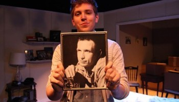 Chicago director Jake Fruend holding a photo of John, a mysterious friend from his grandmothers past.