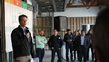 Founder Andrew Lutsey addresses visitors at Local Foods