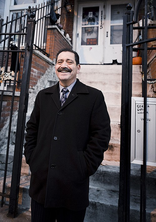 Jesus Chuy Garcia, in front of the three-flat on 17th Street in Pilsen where he lived in 1968 and 1969.