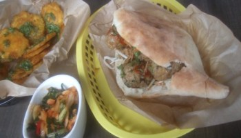 Meatball-noodle sandwich, tostones with chimichurri, and cabbage-fennel kimchi at Belly Shack