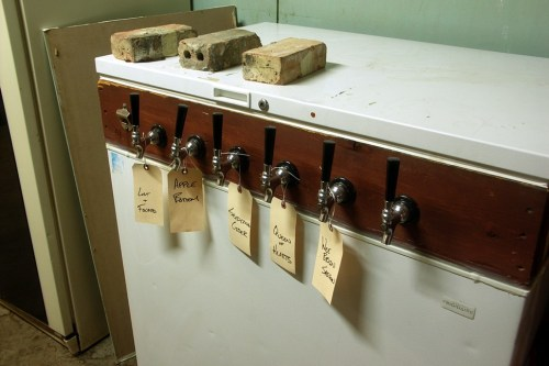 The CHAOS keezer. (The word was new to me--its a portmanteau of kegerator and freezer.) Its taps are usually a mix of leftovers from parties and beers brewed to share at the space.