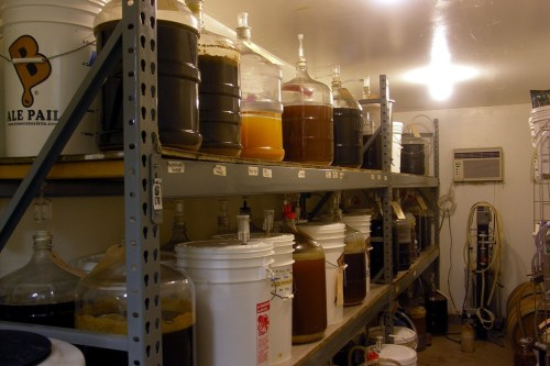 The fermentation room, pegged at 65 degrees. Not pictured: A carboy with aluminum foil over its mouth instead of an airlock. Not up to spec, said CHAOS board member Jamie Proctor.