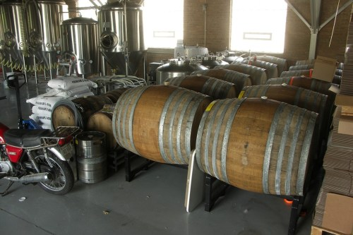 Transients corner of the Aquanaut brewing floor, with motorcycle for scale