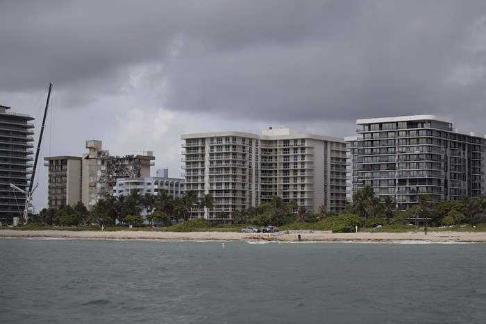 Surfside Mayor Charles Burkett recommended that residents of Champlain Towers North (far right) evacuate - PHOTO BY JOE RAEDLE / GETTY IMAGES
