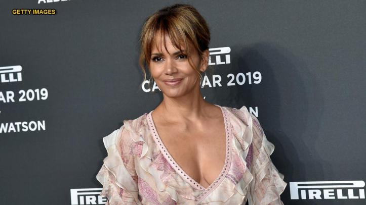 Halle Berry's steamy Instagram snap with unbuttoned jacket stuns