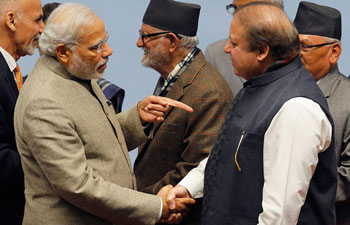 """Prime Minister <a href=""""http://indiatoday.intoday.in/people/narendra-modi/17737.html"""">Narendra Modi</a> shakes hands with Pakistan Prime Minister Nawaz Sharif during the closing session of 18th SAARC summit in Kathmandu. Photo: Reuters."""