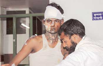 One of the victims of the alleged communal clash in Bharatpur is treated at Sawai Man Singh Hospital