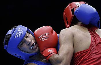 Kazakhstan's Danabek Suzhanov fights Vijender, right