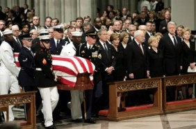 IMAGE: The casket of former President Ronald Reagan is carried inside Washington National Cathedral.