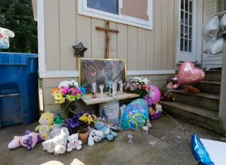 Image: Flowers and stuffed toys left on the doorstep