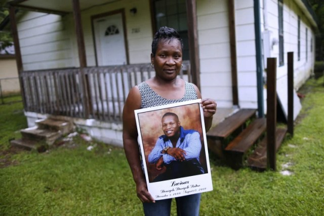 Image: Alma Dunning, mother of Lucious Bolton, holds a photo of her son