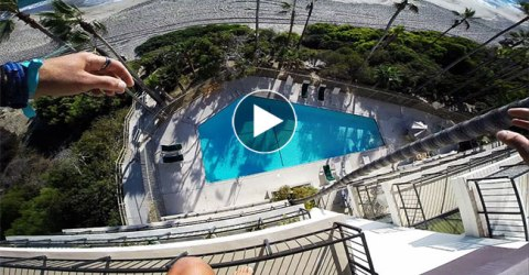 A Daredevil Jumps off a Roof of a Hotel!!