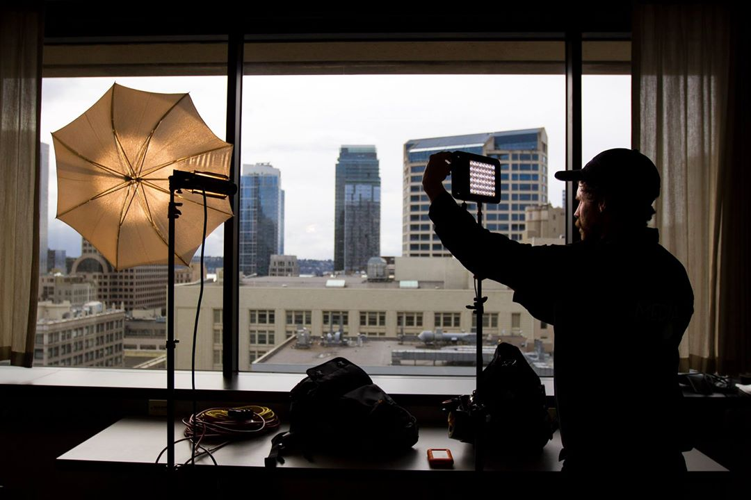Behind-the-scenes photo of a Media272 videographer setting up for a shoot with CenturyLink