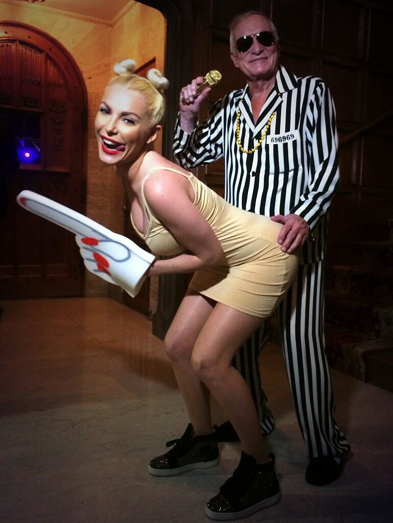 Hugh Hefner sported a striped suit as Robin Thicke, re-creating the MTV VMAs performance with Crystal Harris as Miley Cyrus.<br /><br /> Source: Twitter user hughhefner<br /><br />