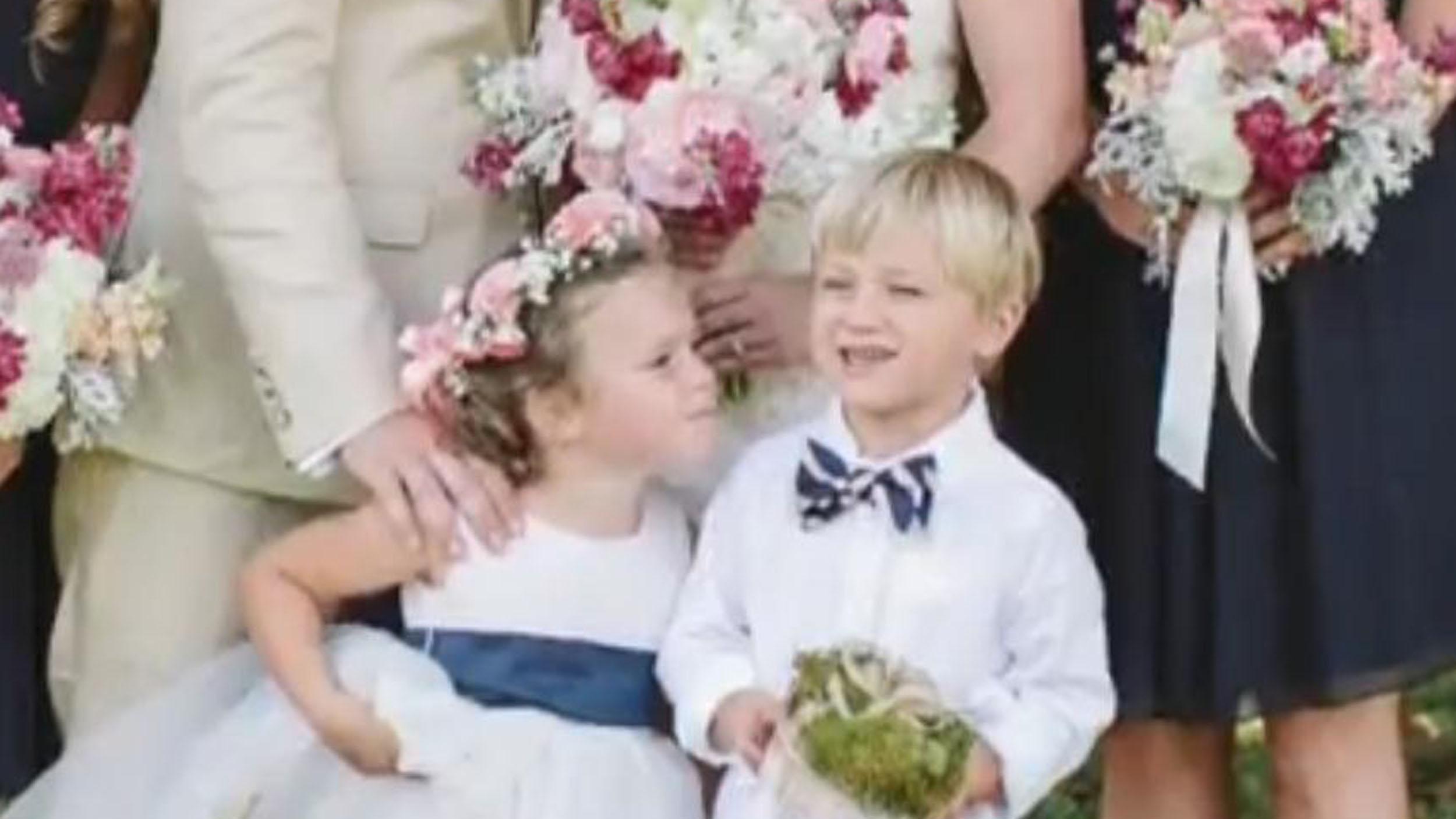 Flower Girl Steals Kiss From Ring Bearer At Moms Wedding
