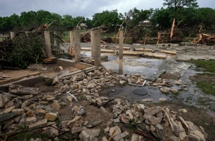 Image: The cement stilts of the home belonging to the Carey family of Corpus Christi, Texas, are all that remain the home was swept away by the Blanco River early  Sunday morning during a flash flood in Wimberley, Texas
