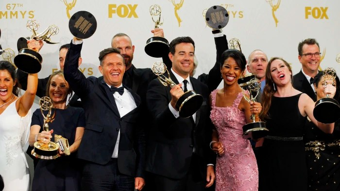 """Image: Producers and crew of """"The Voice"""" pose with their awards during the 67th Primetime Emmy Awards in Los Angeles"""