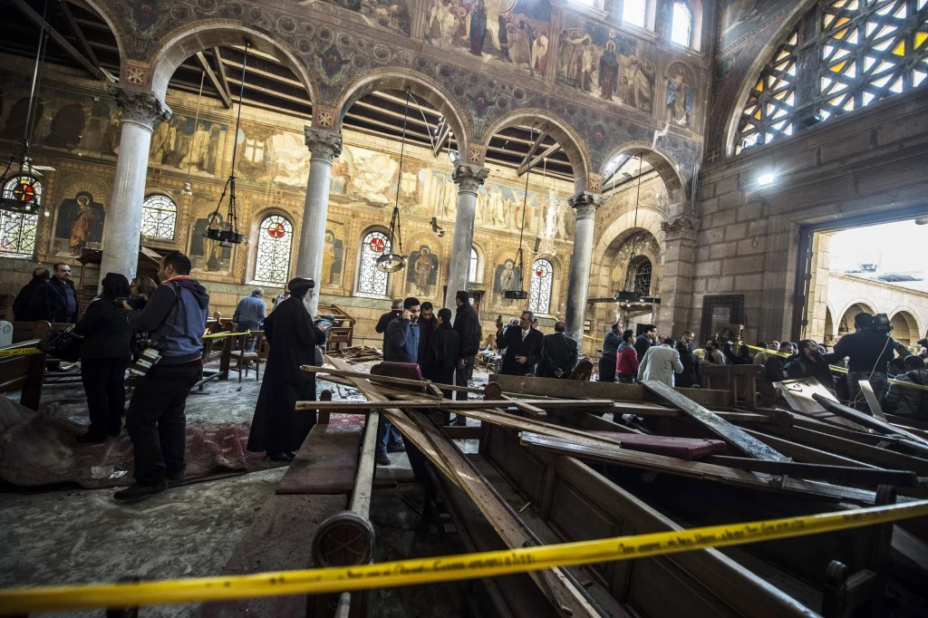 Image result for Egyptian security officials and investigators inspect the scene following a bombing inside Cairo's Coptic cathedral in Egypt December 11, 2016. © Amr Abdallah Dalsh