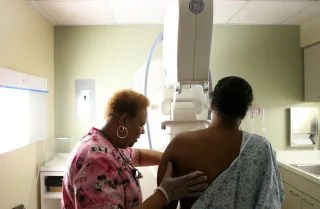 Image: A woman undergoes her yearly mammogram in Chicago.