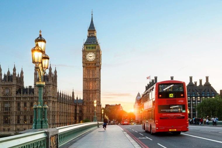 Image: A bus on Westminster Bridge with Big Ben in the background in London