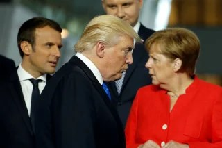 Image: President Donald Trump walks past French President Emmanuel Macron and German Chancellor Angela Merkel