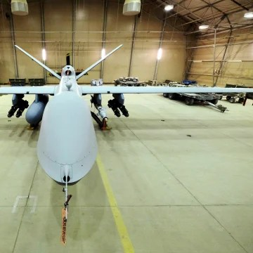 A U.S. Air Force MQ-9 Reaper drone sits armed with Hellfire missiles and a 500-pound bomb in a hanger at Kandahar Airfield, Afghanistan