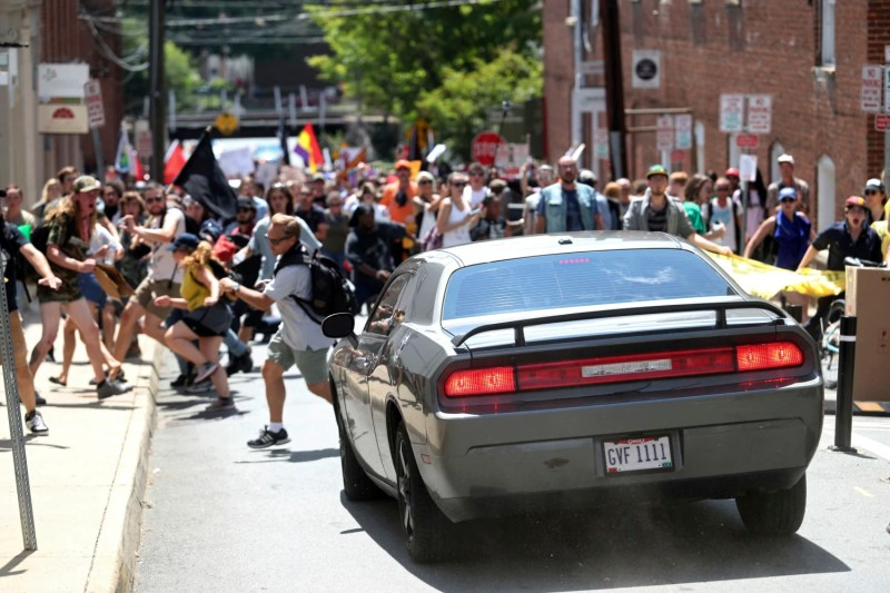Image A Vehicle Drives Into A Group Of Protesters Demonstrating Against A White Nationalist Rally