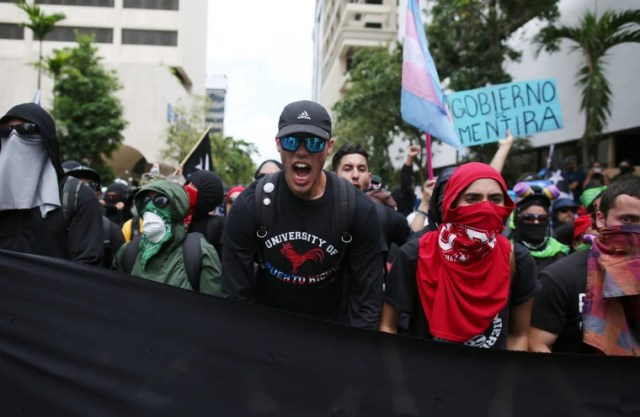 Image: Demonstrators march during a May Day protest against austerity measures, in San Juan