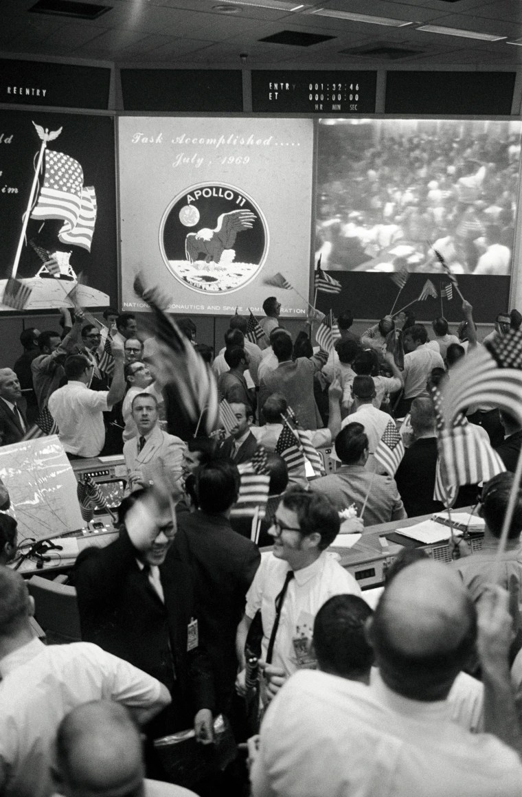 Image: flight controllers applaud the splashdown and success of the Apollo 11 lunar mission