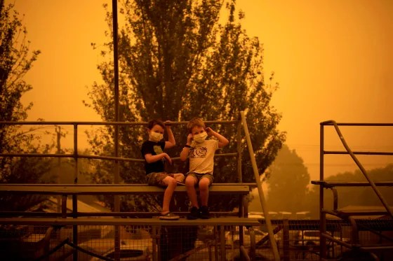 Image: Children wear masks to protect them from smoke as they play at an evacuation site in Bega, New South Wales on Dec. 31, 2019.