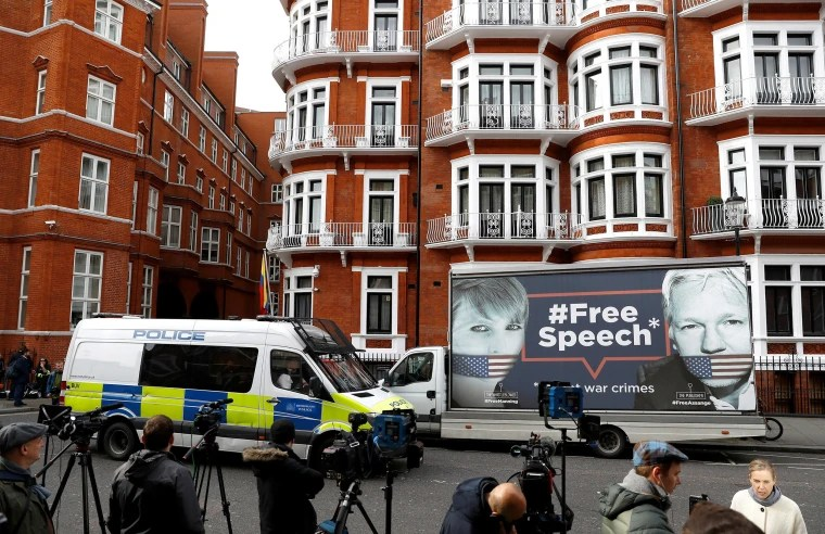 Image: A police van and truck outside the Ecuadorian Embassy in London
