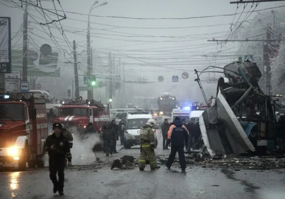 Members of the emergency services work at the site of a bomb blast on a trolleybus in Volgograd December 30, 2013. At least 10 people were killed when...