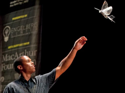 (10/11/2013) Cameron Rose, of UC Berkeley Biomimetric Millisys Lab, catches a drone resembling a bird at the DARC conference's AfterDARC session in NY...