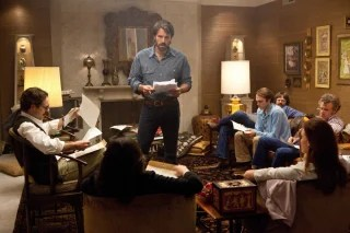 """This film image released by Warner Bros. Pictures shows Ben Affleck as Tony Mendez, center, in """"Argo,""""  a rescue thriller about the 1979 Iranian hosta..."""