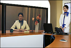 In a Tokyo demonstration using ultra-high-speed broadband, a life-size, high-definition image of a distant colleague is projected onto a screen.