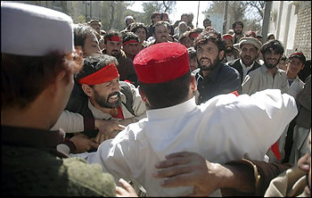 Supporters of a losing political candidate scuffle during a protest outside the government administrator's office in Peshawar, Pakistan on Tuesday, Feb. 19, 2008. Pakistan's ruling party conceded defeat Tuesday after opposition parties routed allies of President Pervez Musharraf in parliamentary elections that could threaten the rule of America's close ally in the war on terror. (AP Photo/Mohammad Zubair)