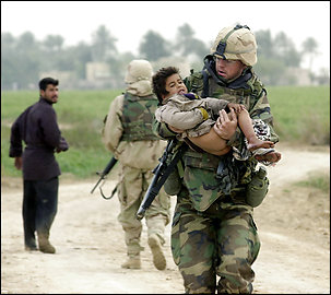 This photo and the previous one show the sequence of events leading up to the famous image of Dwyer carrying Sattar that made front pages worldwide in March 2003.