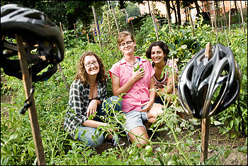 Liz Tylander, left, Kat Shiffler and Lara Sheets in the Twin Oaks Community Garden. The women cycled to Montreal, filming urban and suburban farming along the way for a documentary.