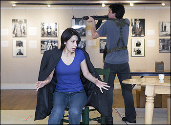 """Alexander Strain and Maia DeSanti play a Serbian soldier and the Bosnian woman he terrorizes in Theater J's world premiere of """"Honey Brown Eyes."""""""