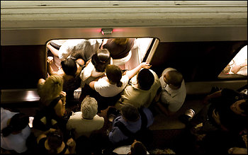 Commuters crowd platforms at the Rosslyn Metro station during peak hours. For the four months ending in October, Metrorail ridership in the Washington region was up 5 percent over the same period last year, an official says.