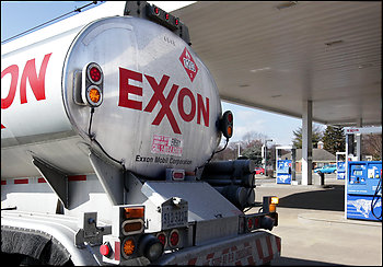 While posting a $45.2 billion in annual profits, Exxon Mobil suffered a sharp drop in fourth-quarter profits from producing oil and gas.