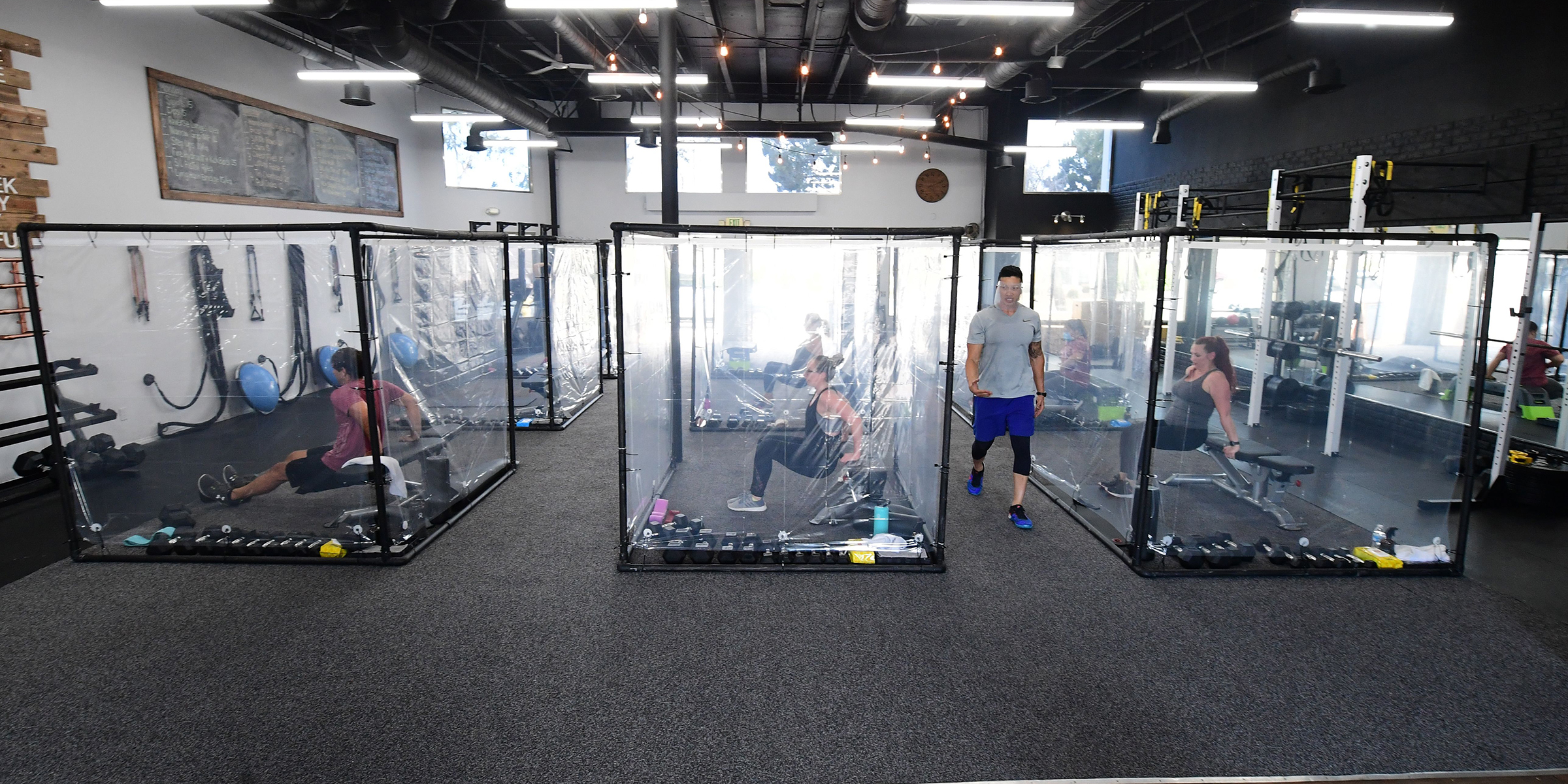 gym debuts workout pods made from shower curtains as chains increase sanitation