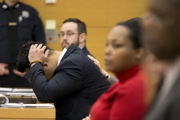 Image: New York City Police officer (NYPD) Peter Liang is lead from the court room at the Brooklyn Supreme court in the Brooklyn borough of New York