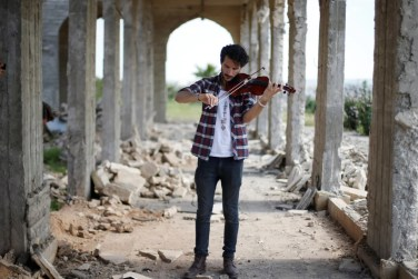 Image result for Iraqi violinist plays in Mosul as troops battle