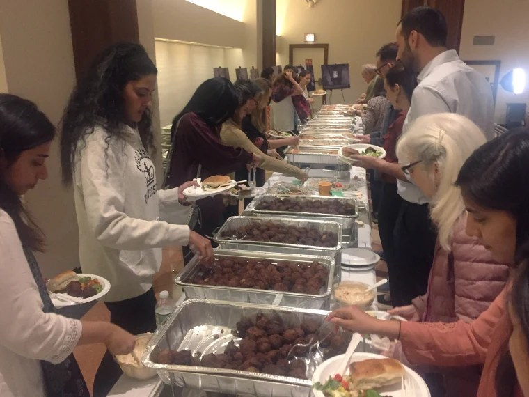 Image: Attendees at an iftar dinner at a Jewish congregation in New York