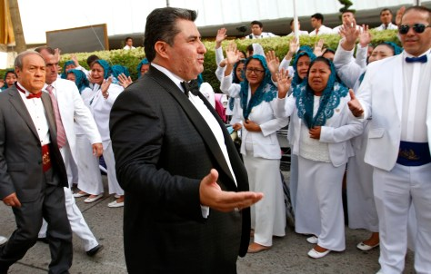 Image: Joaquin Garcia greets members of the La Luz del Mundo Church in Guadalajara, Mexico, on Aug. 14, 2018.